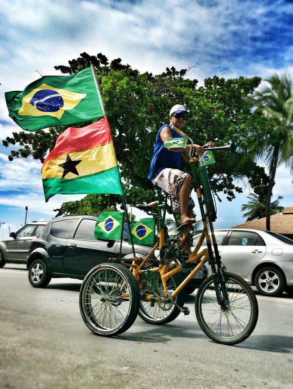 Brazilian cyclist rides in Maceio with big Ghana flag to support Black Stars